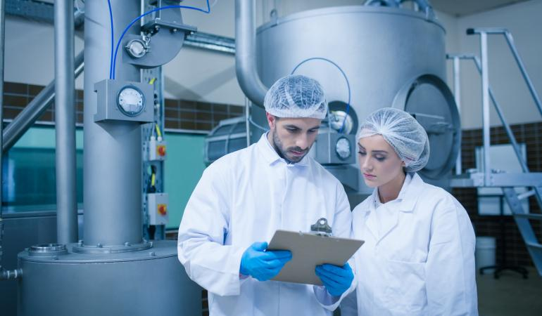 photodune-10077784-food-technicians-working-together-in-a-food-processing-plant-l